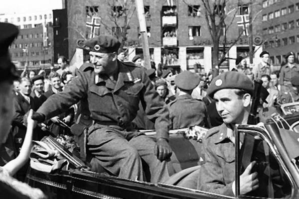 June 7, 1945: Crown Prince Olaf returns to Oslo.  His bodyguard is noted Norwegian commando Max Manus - about whom more soon.